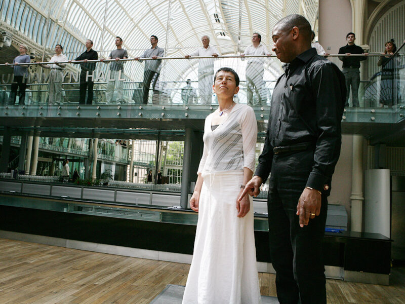 Michel Harper and Helen in the dress rehearsal of Helen Chadwick's THE SINGING CIRCLE in the Floral Hall at The Royal Opera House